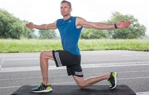 Athletic man doing a Lunge and Twist